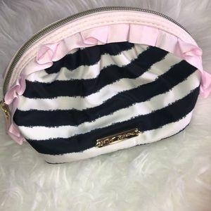 Betsy Johnson ruffle makeup bag